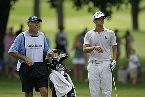 Adam Scott, right, and caddie Steve Williams during the second round of the Bridgestone Invitational golf tournament at Firestone Country Club in Akron, Ohio Friday, Aug. 5, 2011.