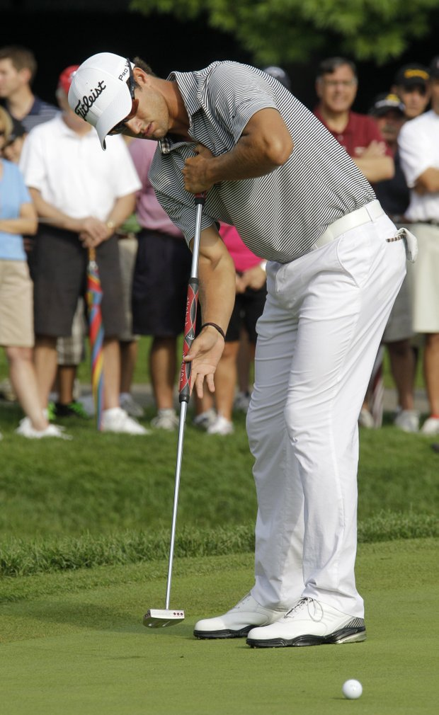 Adam Scott, from Australia, watches his birdie putt come up short on the first hole during the third round of the Bridgestone Invitational golf tournament at Firestone Country Club in Akron, Ohio Saturday, Aug. 6, 2011.
