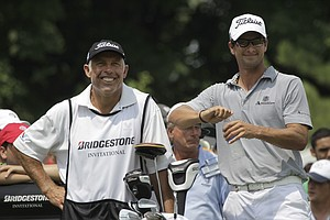 Adam Scott from Australia, right, and his caddie Steve Williams share a laugh on the 17th tee during third round play in the Bridgestone Invitational golf tournament at Firestone Country Club in Akron, Ohio on Saturday, Aug. 6, 2011.