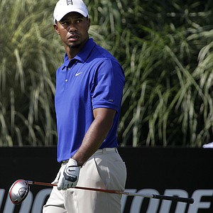 Tiger Woods looks back after hitting his drive from the 16th tee during third round play in the Bridgestone Invitational golf tournament at Firestone Country Club in Akron, Ohio on Saturday, Aug. 6, 2011.