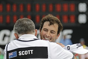 Adam Scott, from Australia, hugs caddie Stave Williams after winning the Bridgestone Invitational golf tournament at Firestone Country Club in Akron, Ohio, Sunday, Aug. 7, 2011. Scott finished at 17 under par for a four-shot win.
