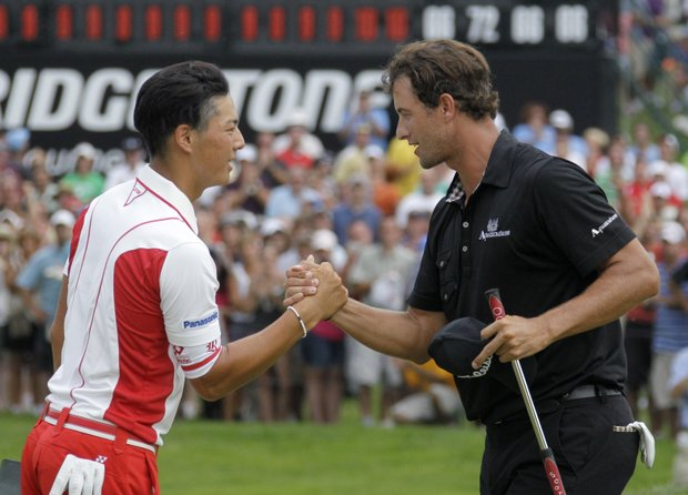 Adam Scott, from Australia, right, is congratulated by Ryo Ishikawa, from Japan, after Scott won the Bridgestone Invitational golf tournament at Firestone Country Club in Akron, Ohio Sunday, Aug. 7, 2011. Ishikawa tied for fourth.
