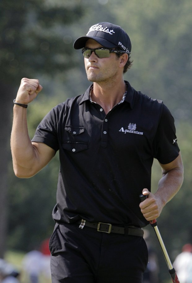Adam Scott, from Australia, pumps his fist after making birdie on the 14th hole during the final round of the Bridgestone Invitational golf tournament at Firestone Country Club in Akron, Ohio, Sunday, Aug. 7, 2011. Scott won the tournament.