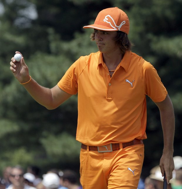 Rickie Fowler acknowledges the gallery after making birdie on the first hole during final round play in the Bridgestone Invitational golf tournament at Firestone Country Club in Akron, Ohio, Sunday, Aug. 7, 2011.