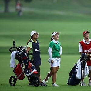 Moriya Jutanugarn, second from left, and Demi Frances Runas, far right, watch a player's ball flight at No. 13.
