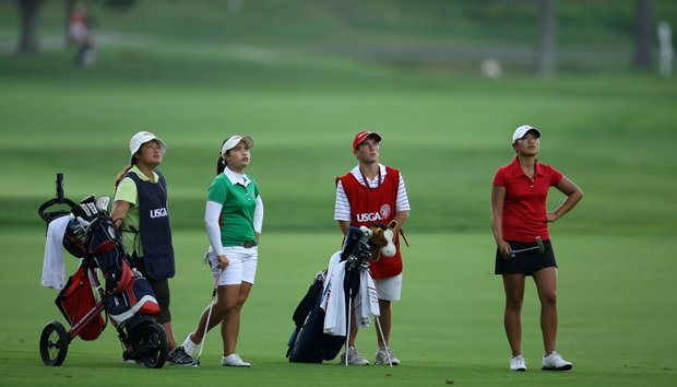 Moriya Jutanugarn, second from left, and Demi Frances Runas, far right, watch a player's ball flight at No. 13.