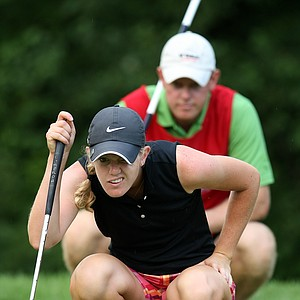 Amy Anderson lines up a putt with her brother/caddie, Nathan.