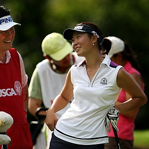 Erynne Lee shares a laugh with her caddie during Monday stroke play.