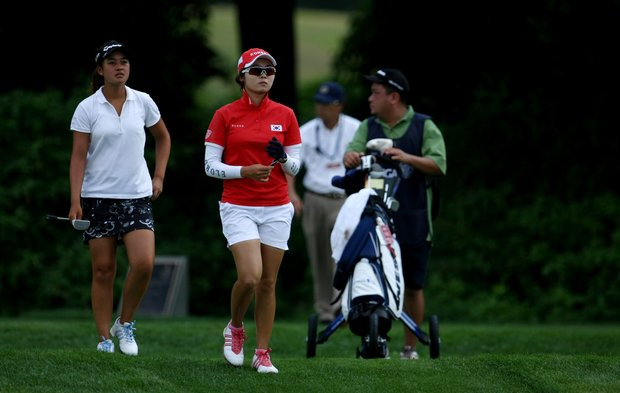 Jihee Kim and Gabriella Then leave the tee at No. 17 during Monday stroke play of the U. S. Women's Amateur Championship at Rhode Island Country Club in Barrington, Rhode Island.