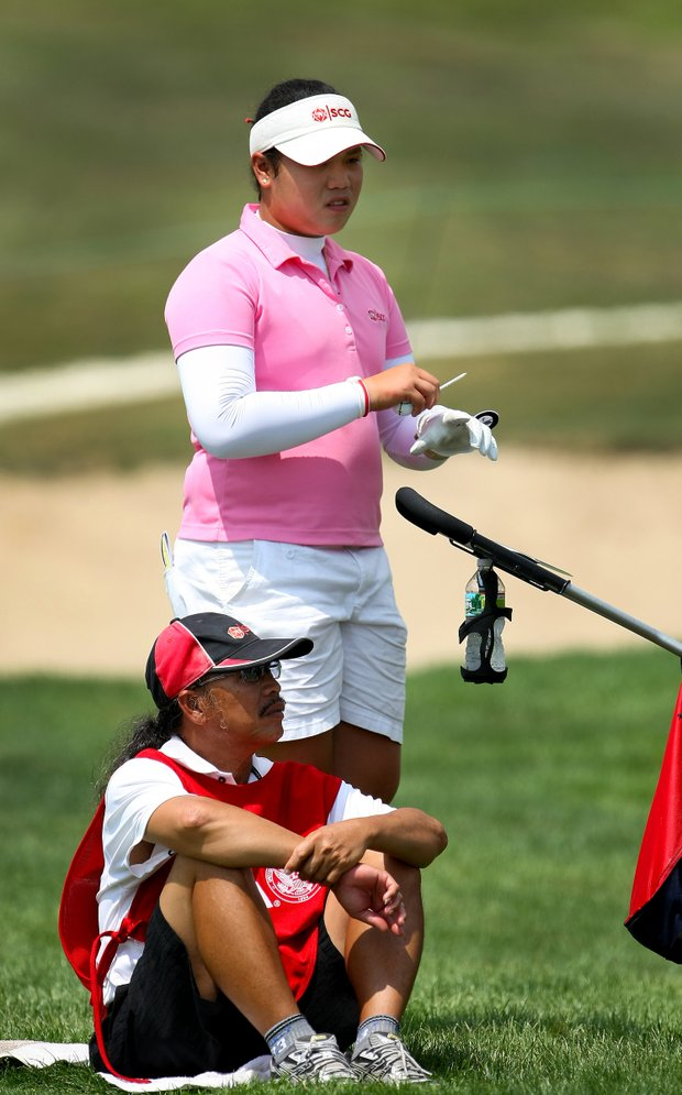 Ariya Jutanugarn of Thailand with her father/caddie, Somboom, during Monday stroke play of the U. S. Women's Amateur Championship at Rhode Island Country Club in Barrington, Rhode Island.
