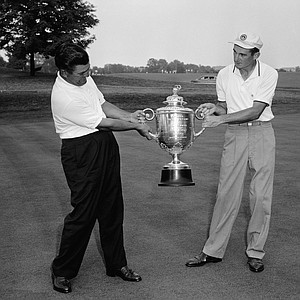 """Friendly """"tug-o- war"""" is enacted by two finalists for PGA Championship Cup July 20, 1957 after Lionel Hebert, left, of Laffayette, La. and Dow Finsterwald, a Florida professional defeated their semi-final opponents in Dayton, Ohio."""