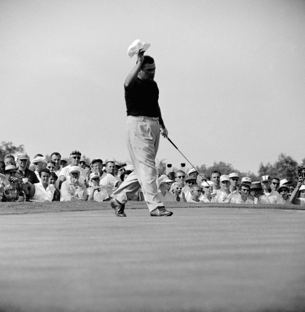 Waving cap, PGA champ Lionel Herbert of Lafayette, La., moves across 31st green July 21, 1957 in Dayton, Ohio after crowd applauded long putt for birdie two. Herbert went into lead that gave him 2 and 1 victory over Dow Finsterwald.