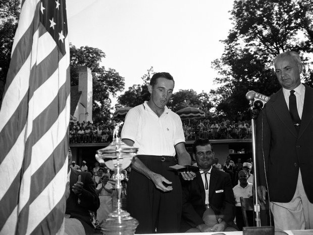 Dow Finsterwald, second in PGA Championship in 1957, holds check on July 21, 1957.