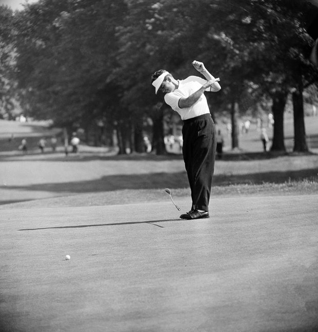Golfer Jack Burke, Jr. slaps his putter to the turf in exasperation after missing a birdie putt on the second green during the National PGA Championship in Akron, Ohio, July 22, 1960.