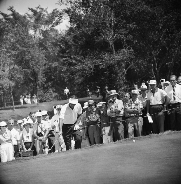 First round leader in PGA championship, Arnold Palmer ran into trouble on the front nine when he bogied four holes on July 22, 1960 in Akron. Here he climbs to the 4th green after shooting from the rough. He got a bogey five.