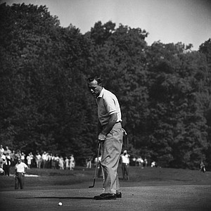 Arnold Palmer stares down at ball on first green of Aronimink Golf Club on July 19, 1962 at Newtown Square, Pa., after the missed short putt for birdie during first round play in the PGA tournament today. Palmer was paired with Jack Nicklaus who defeated him for the National Open championship.