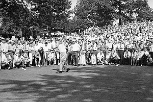 Arnold Palmer, center, seeking the PGA crown, tees off in first round play of the tournament at Aronimink Golf Club, July 19, 1962, Newtown Square, Penn. Jack Nicklaus, who beat him for the National Open championship, stands behind him. The Palmer-Nicklaus-Dave Marr threesome attracted the largest gallery in first day play.