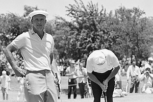 Arnold Palmer of Ligonier, Pa. pretends to wring the neck of his putter after missing a putt during the final practice round for the PGA championship at Dallas Athletic Club Country Club in Dallas on July 17, 1963.