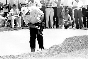 Jack Nicklaus, of Tuscon, Ariz., hits the ball from the trap on the 16th green of the Dallas Athletic Country Club in the opening round of the PGA Championship in Dallas, Texas, on July 18, 1963. Nicklaus was the early leader with a 2-under-par 69.