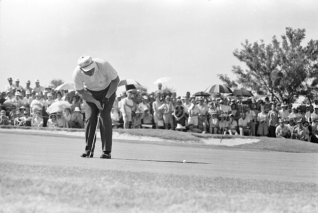 Jack Nicklaus sinks the final putt on the 18th green to win the 45th PGA Championship at the Dallas Athletic Club in Dallas, Texas, on July 21, 1963. Nicklaus beat Dave Ragan Jr. in the 72-hole match with a score of 279.