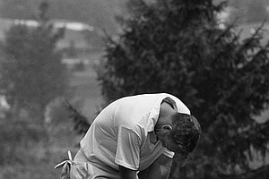 Arnold Palmer leans on his putter and hangs head in perspiring dejection after he double bogied ninth hole in third round play of the PGA Championship. Palmer, playing on his home course on August 14, 1965 at Ligonier, Pa., started the round with 147, five over par and ten strokes behind the leader. He wound up with a 221, for eight over par.