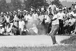 Dave Marr hits ball from sand trap along fairway on 18th hole in 47th playing of the PGA Championship as the four-day tourney went right down to the wire on Aug. 16, 1965 in Ligonier, Pennsylvania. He wound up with a four-under par 280, two strokes ahead of a tie for second between Billy Casper and Jack Nicklaus.