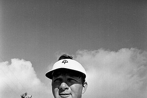 Arnold Palmer, of Latrobe, Pa., pulls on his glove before practice round for the PGA National Championship at Pecan Valley Country Club in San Antonio, Texas, July 17, 1968.