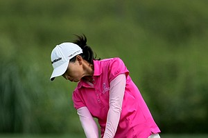 Doris Chen hits a shot at No. 18.