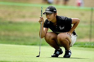 Lydia Ko lines up at putt at No. 6 during Tuesday stroke play of the U. S. Women's Amateur Championship at Rhode Island Country Club in Barrington, Rhode Island.