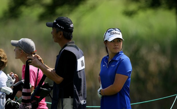 Danielle Kang, defending champion, watches the action behind her during Tuesday stroke play of the U. S. Women's Amateur Championship at Rhode Island Country Club in Barrington, Rhode Island.