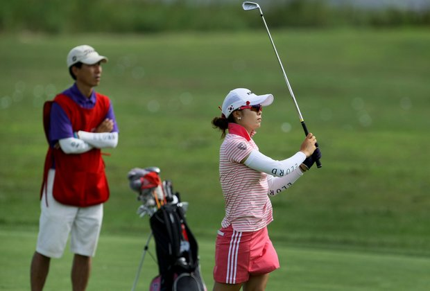 Jihee Kim hits a shot at No. 18 during Tuesday stroke play of the U. S. Women's Amateur Championship at Rhode Island Country Club in Barrington, Rhode Island.