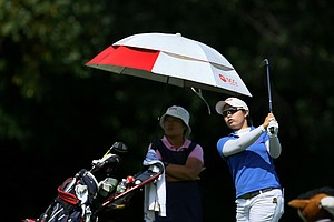 Moriya Jutanugarn hits a shot at No. 6 with her mom, Narumon, during Tuesday stroke play of the U. S. Women's Amateur Championship at Rhode Island Country Club in Barrington, Rhode Island.