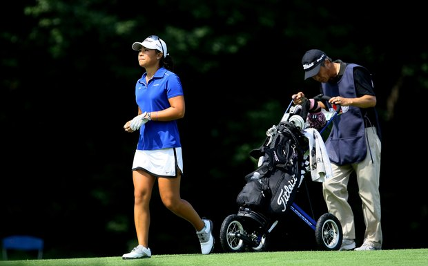 Danielle Kang with her father/caddie K. S. Kang during Tuesday stroke play of the U. S. Women's Amateur Championship at Rhode Island Country Club in Barrington, Rhode Island.
