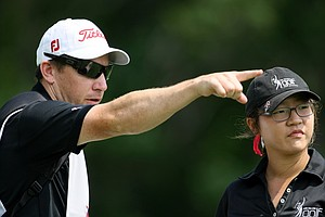 Lydia Ko with her caddie/coach Guy Wilson during Tuesday stroke play of the U. S. Women's Amateur Championship at Rhode Island Country Club in Barrington, Rhode Island.
