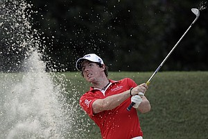 Rory McIlroy, of Northern Ireland, hits out of a bunker on the third hole during a practice round for the PGA Championship golf tournament Tuesday, Aug. 9, 2011, at the Atlanta Athletic Club in Johns Creek, Ga.