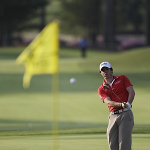 Rory McIlroy, of Northern Ireland, hits a shot during a practice round for the PGA Championship golf tournament Tuesday, Aug. 9, 2011, at the Atlanta Athletic Club in Johns Creek, Ga.