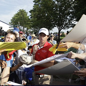 Rory McIlroy, of Northern Ireland, signs some autographs during a practice round for the PGA Championship golf tournament Tuesday, Aug. 9, 2011, at the Atlanta Athletic Club in Johns Creek, Ga.