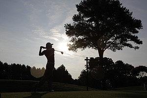 Rory McIlroy, of Northern Ireland, watches a shot during a practice round for the PGA Championship golf tournament Tuesday, Aug. 9, 2011, at the Atlanta Athletic Club in Johns Creek, Ga.