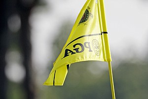 Dustin Johnson pulls out the flag on the sixth hole during a practice round for the PGA Championship golf tournament Tuesday, Aug. 9, 2011, at the Atlanta Athletic Club in Johns Creek, Ga.