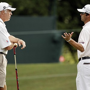 Adam Scott, of Australia, talks to caddie Steve Williams, left, on the 15th hole during a practice round for the PGA Championship golf tournament Tuesday, Aug. 9, 2011, at the Atlanta Athletic Club in Johns Creek, Ga.