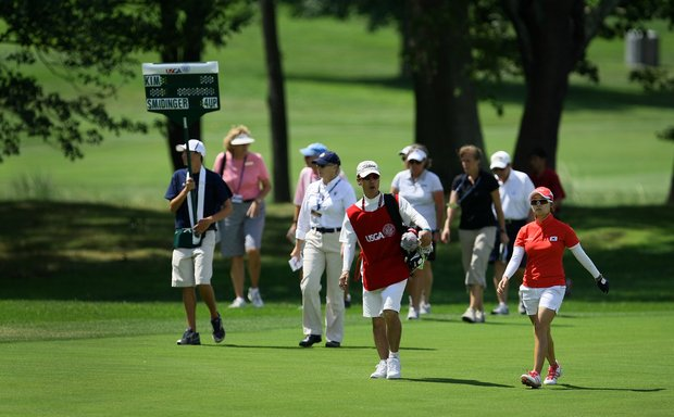 Jihee Kim walks down the fairway at No. 13 already 4-down in her match during the Round of 64 at the U. S. Women's Amateur Championship at Rhode Island Country Club in Barrington, Rhode Island.