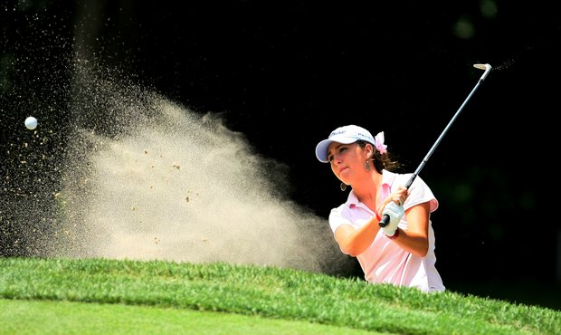 Jaye Marie Green hits out of the bunker at No. 13 during the Round of 64 at the U. S. Women's Amateur Championship at Rhode Island Country Club in Barrington, Rhode Island.