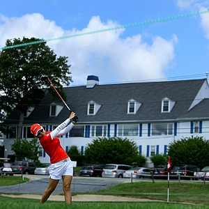 Co-medalist Jihee Kim hits her tee shot at No. 16 during the Round of 64 at the U. S. Women's Amateur Championship at Rhode Island Country Club in Barrington, Rhode Island. The clubhouse of the Rhode Island Country Club is in the background.
