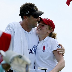 Elyse Smidinger celebrates with her caddie/father, Eric, after defeating the co-medalist, Jihee Kim during the Round of 64 at the U. S. Women's Amateur Championship at Rhode Island Country Club in Barrington, Rhode Island.