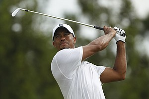 Tiger Woods drives during a practice round for the PGA Championship golf tournament Tuesday, Aug. 9, 2011, at the Atlanta Athletic Club in Johns Creek, Ga.