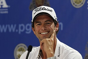 Adam Scott, of Australia, answers a question at a news conference at the PGA Championship golf tournament Tuesday, Aug. 9, 2011, at the Atlanta Athletic Club in Johns Creek, Ga.