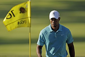 Tiger Woods makes his way to the 16th green during a practice round for the PGA Championship golf tournament Wednesday, Aug. 10, 2011, at the Atlanta Athletic Club in Johns Creek, Ga.