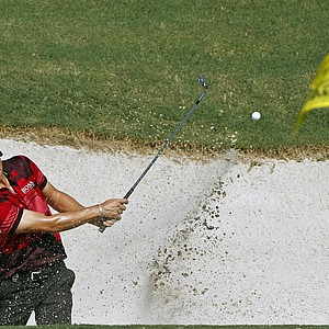 Martin Kaymer, of Germany, hits out of a bunker on the 18th hole during a practice round for the PGA Championship golf tournament Wednesday, Aug. 10, 2011, at the Atlanta Athletic Club in Johns Creek, Ga.