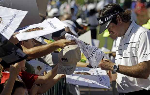 Bubba Watson signs autographs during a practice round for the PGA Championship golf tournament Wednesday, Aug. 10, 2011, at the Atlanta Athletic Club in Johns Creek, Ga.