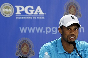 Tiger Woods answers a question during a news conference at the PGA Championship golf tournament Wednesday, Aug. 10, 2011, at the Atlanta Athletic Club in Johns Creek, Ga.